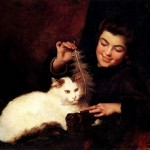 Девушка играет с котом