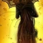 женский силуэт на фоне осеннего пейзажа